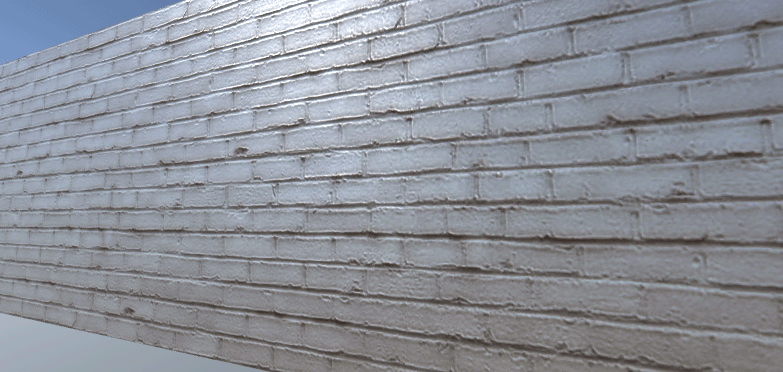 The wall in Scene view with a normal and specular map applied