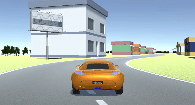 A scene with a car on the newly-built road in Unity